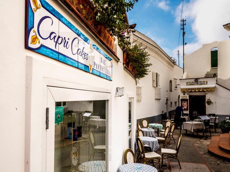 Tiled Capri Cakes sign on cafe