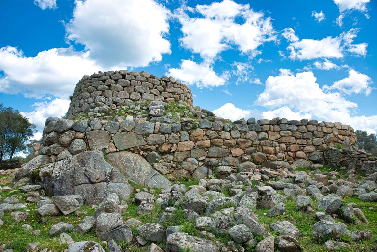 Nuraghe on the island of sardinia Italy,what is known about the Nuragic,is that it was a people of shepherds and farmers into small communities who lived in Sardinia for 8 centuries.
