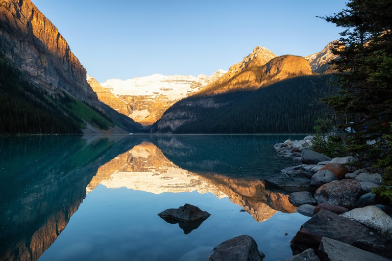 Lake Louise during a vibrant summer sunrise. Taken in Banff, Alberta, Canada.