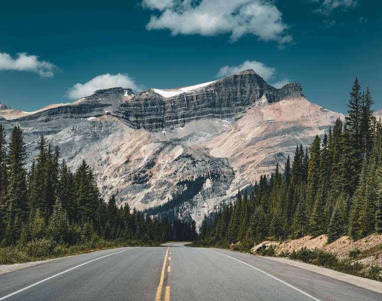 Empty Icefields Parkway Street with Mountain Panorama in Banff National Park.