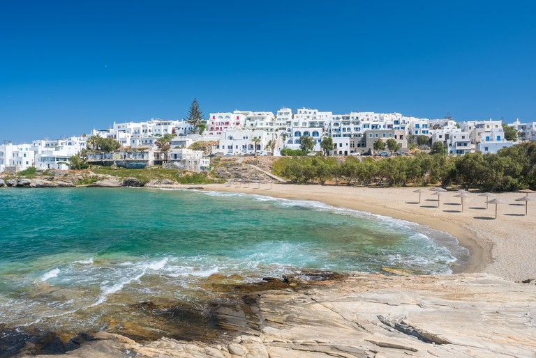 Sandy beach with amazing tranquil water in Naoussa on Paros island, Cyclades, Greece.