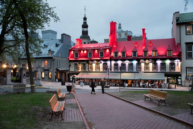 Evening illumination and night-life in the Place d'Armes and Rue Sainte-Anne, Quebec City, Canada