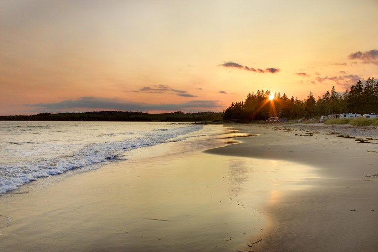 The sun sets beside a campground on Rissers Beach, Nova Scotia