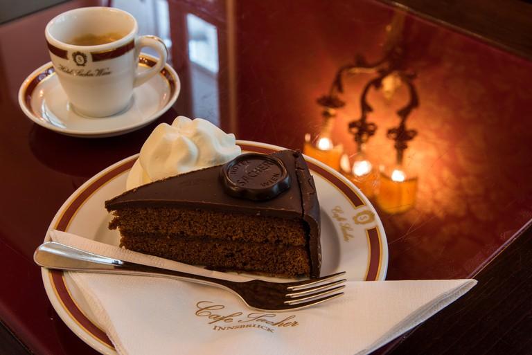 The original Sachertorte chocolate cake served at Cafe Sacher,  Innsbruck, Tyrol, Austria