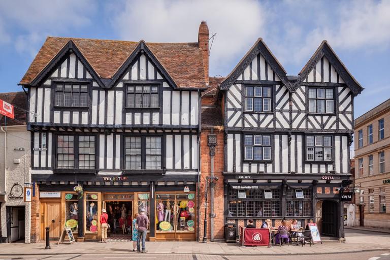 Shops in half-timbered buildings in Bridge Street, Stratford-upon-Avon, Warwickshire, England, UK