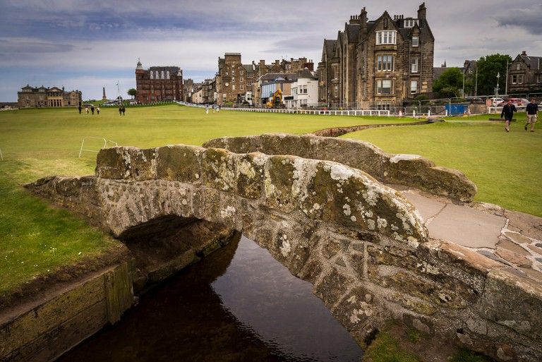 The Swilken Bridge, or Swilken Burn Bridge, is a famous small stone bridge in St Andrews Links golf course, Scotland.. Image shot 05/2014. Exact date unknown.