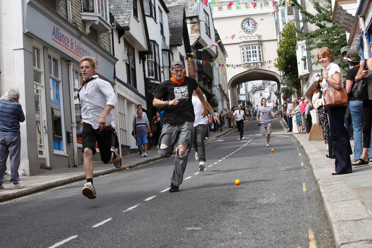 The quirky annual Totnes Orange Races, held on a Summer weekday morning on the High Street in Totnes, Devon, England