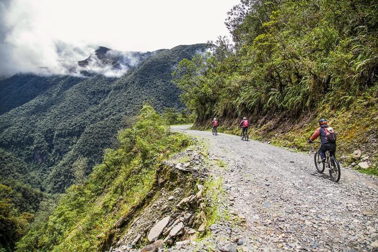 """La Cumbre, Bolivia-Jan 3, 2019: Participants of the descent of The Worlds Most Dangerous Road at La Cumbre pass altitude 4700 m , called """"Death road"""""""