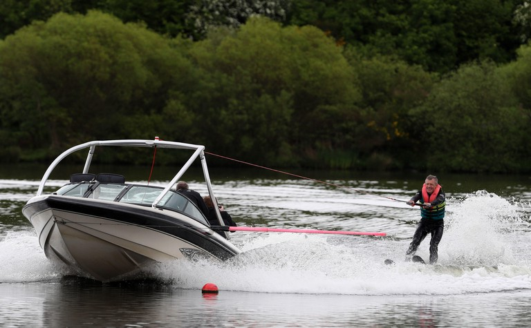 Scottish Liberal Democrat leader Willie Rennie water-skiing at Water Ski and Wakeboard Scotland in Dunfermline as he campaigns for the European elections.