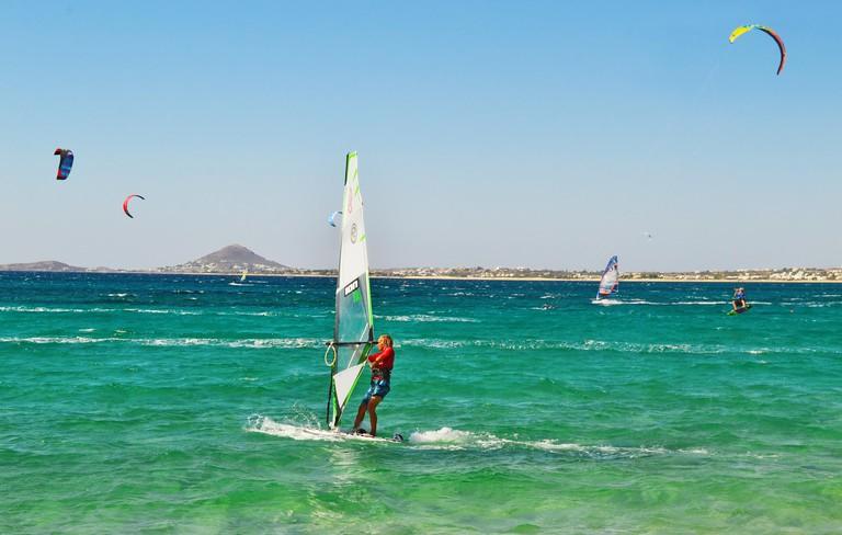 people doing kitesurf and windsurf at Naxos island Cyclades Greece
