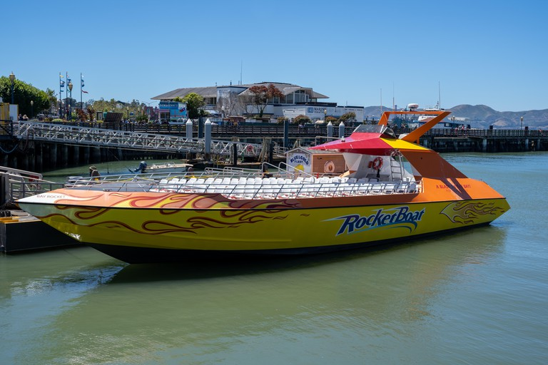 San Francisco, California - July 10, 2019: Rocket Boat tour vessel is docked on the pier of Fishermans Wharf. This jet boat tours the San Franscico ba