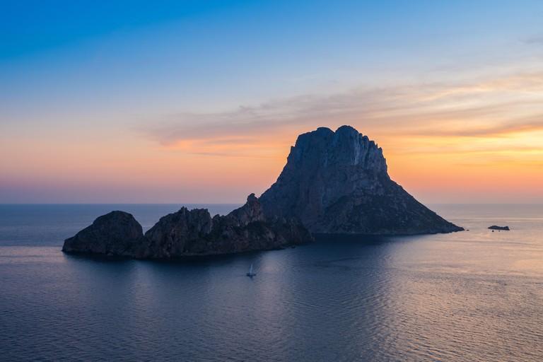 Sunset on mediterranean sea at Ibiza with Es vedra Island
