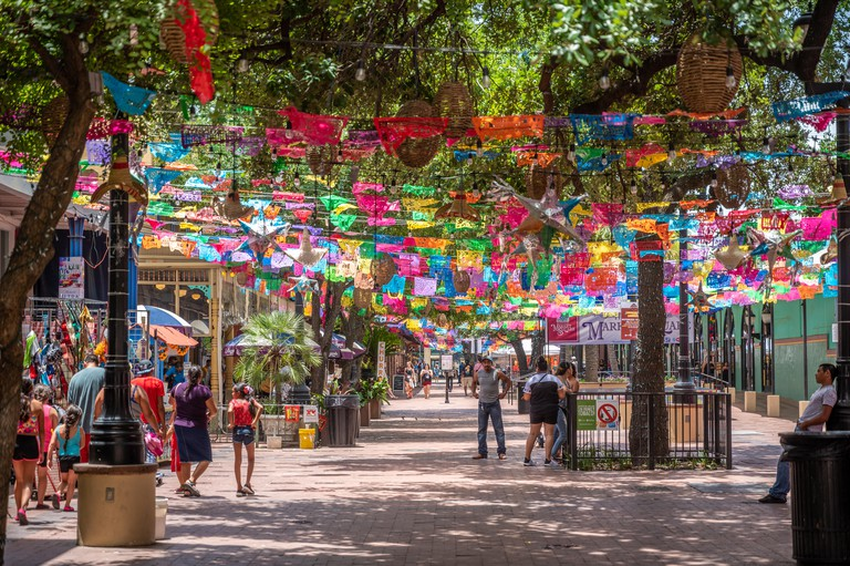 Colorful banners hang across the trees in the historic market square San Antonio, Texas.