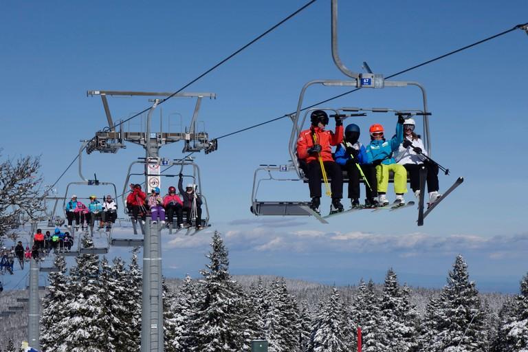 Skiers are riding the Ski Chairlift at Rogla ski resort, Slovenia