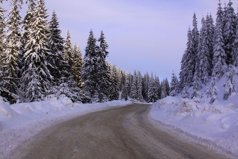 Road to Transalpina ski resort in winter, covered in snow, Romania