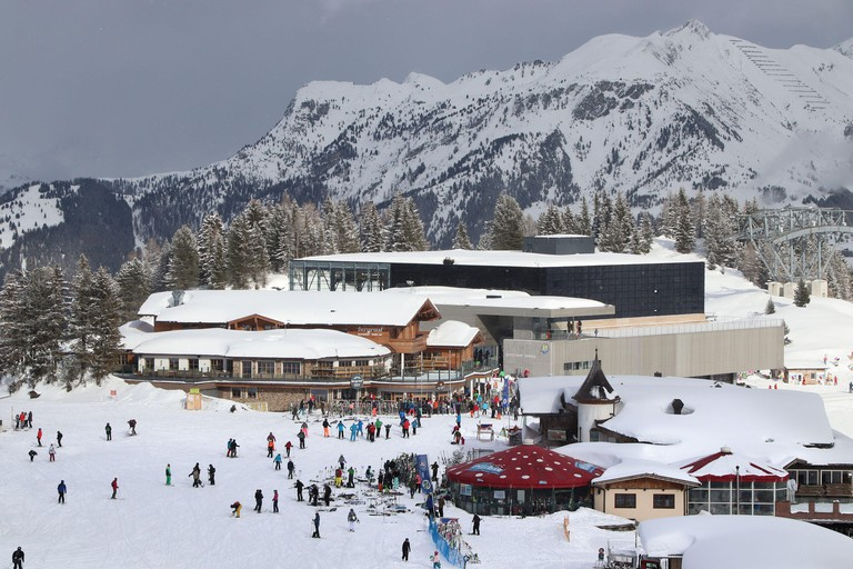 MAYRHOFEN, AUSTRIA - MARCH 13, 2019: People visit Mayrhofen ski resort in Tyrol region, Austria. The resort is located in Zillertal valley of Central