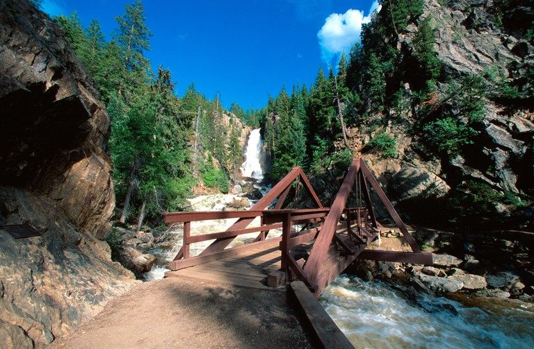 Bridge and Fish Creek Falls Routt National Forest near Steamboat Springs CO USA