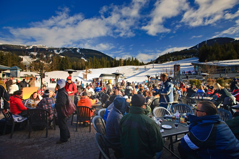 Patrons at the Longhorn Saloon and Grill an apres-ski bar at the base of Whistler Mountain, Whistler Village, British Columbia,