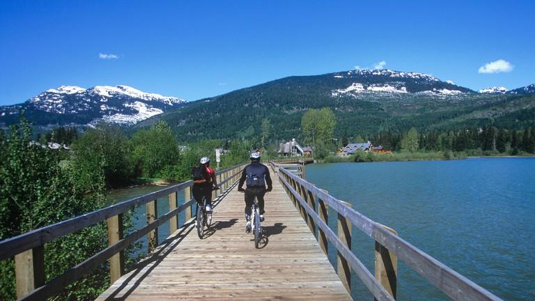 Miles of self guided bike trails loop through Whistler Resort, British Columbia, Canada