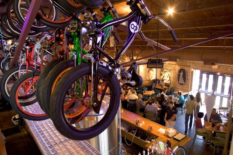 Bikes hung up overlooking a restaurant in San Antonio Texas.