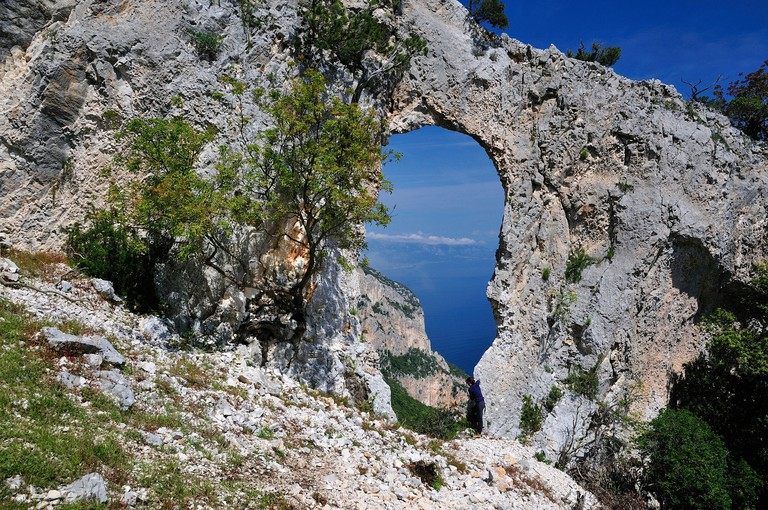 Baunei. Arco di Lopiro. Trekking Selvaggio Blu, Italy, Europe