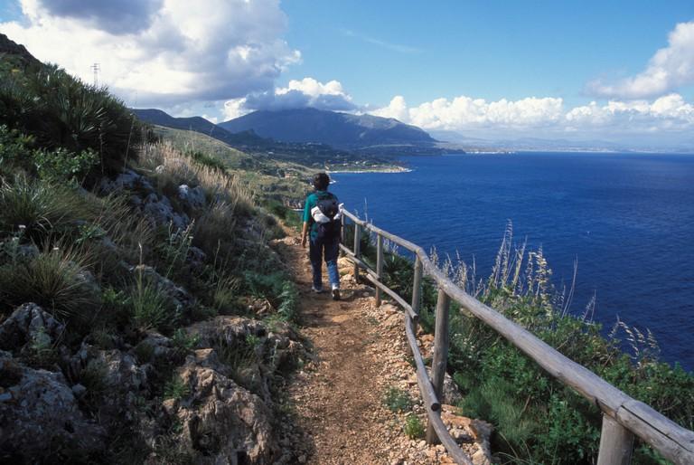 Hiker Zingaro National Preserve Gulf Castellamare Island Sicily Italy Europe model released person hiking