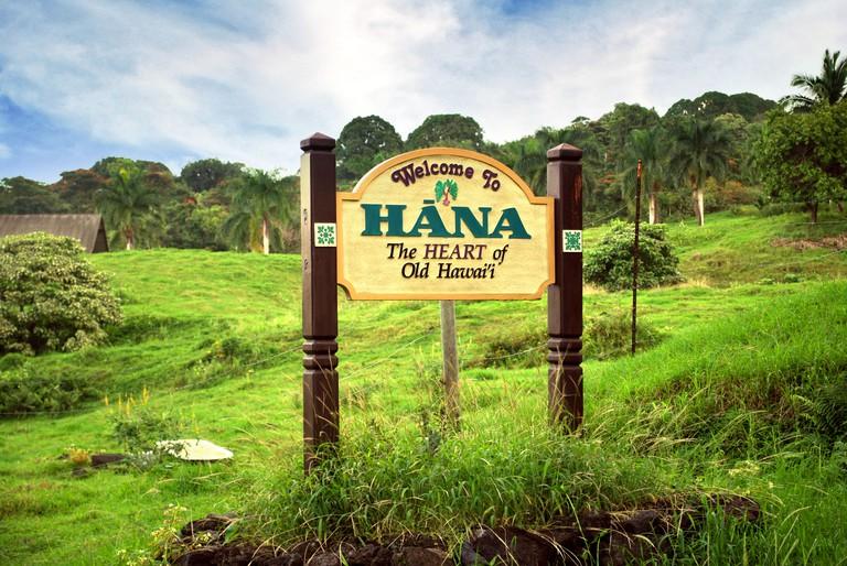 "Sign welcoming visitors to Hana, ""the Heart of old hawaii, Maui Hawaii."