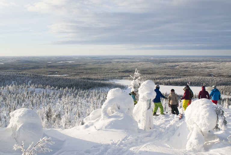 A group of free-skiers admiring the view in Isosyote, Finland