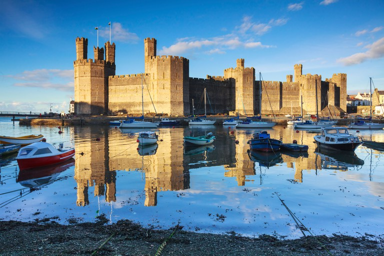Caernarfon Castle in North Wales captured at hight tide
