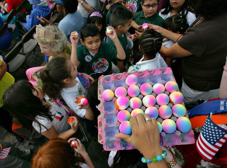 METRO - Children grab for cascarones before ceremoniously cracking them over each other's heads at the Fiesta San Antonio Official Opening Ceremony  Friday, April 18, 2007 in front of the Alamo. BAHRAM MARK SOBHANI/STAFF`
