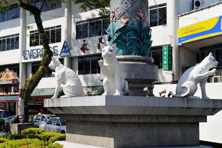 Cat statues at base of pillar in Kuching, Sarawak, Borneo
