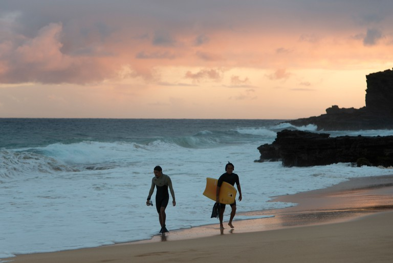 Surfers on the beach, Sandy Beach, Hawaii Kai, Honolulu, Oahu, Hawaii, USA