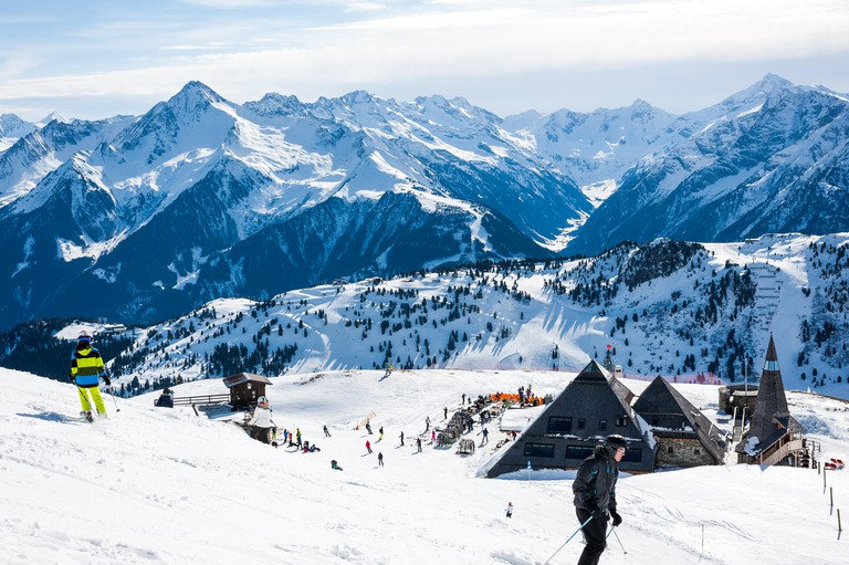 MAYRHOFEN, AUSTRIA :  MARCH 22, 2016:View of  Mayrhofen Ski resort area with ski lifts, pistes and skiers. Zillertal Alps, Tirol