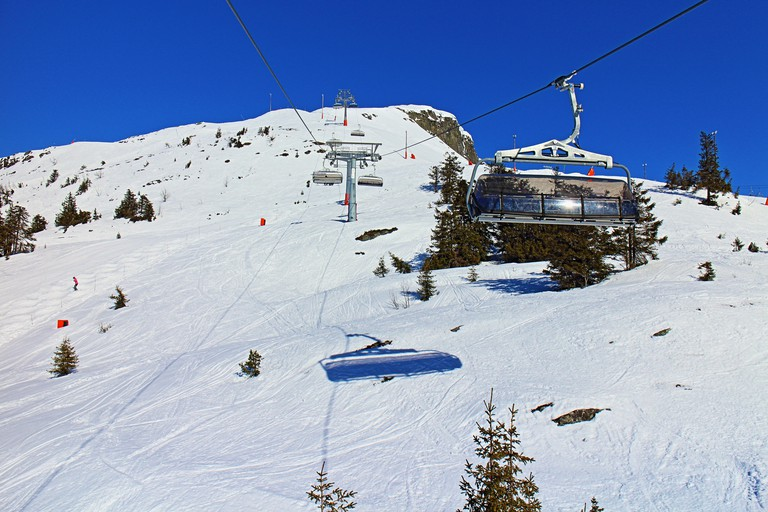Sitting in a chairlift on the way to the top of the mountain
