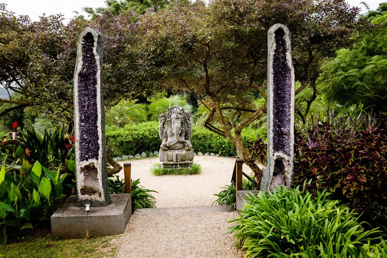 The Amethyst Gateway and Ganesh statue at Crystal Castle and Shambhala Gardens which are close to Byron Bay.