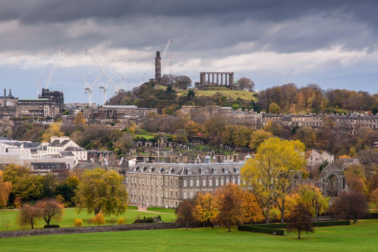 Trees display autumn colours amongst the buildings and parks of Edinburgh city, including Holyrood Palace and Abbey, the Scottish Parliament buildings