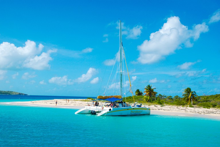The uninhabited Caribbean island, Cayo icacos, in Puerto Rico, that forms part of the Cordillera Keys Nature Reserve with catamaran boat moored