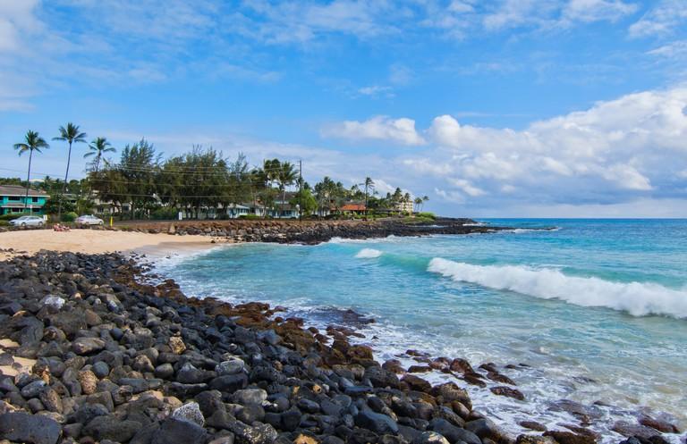 Koloa Kauai Hawaii beautiful beach at Brenneck;s Beach with rocks and waves
