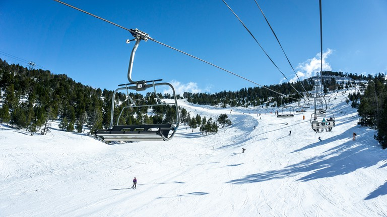 ski slopes with lifts forming perspective photo