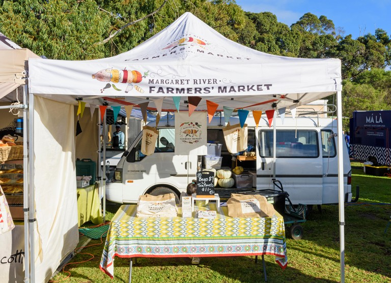 Margaret River Farmers Market stall selling promotion bags and tea towels, Margaret River Town, Western Australia
