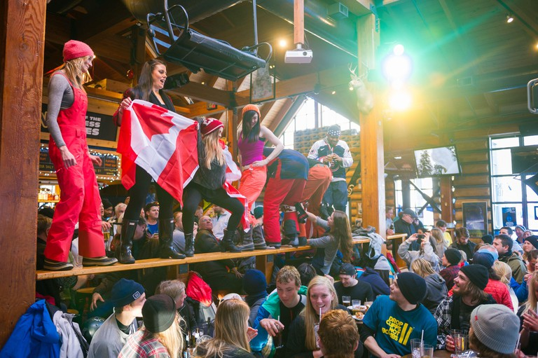 Whistler, BC, Canada: Lively apres at Merlin?s Bar ? Stock Photo