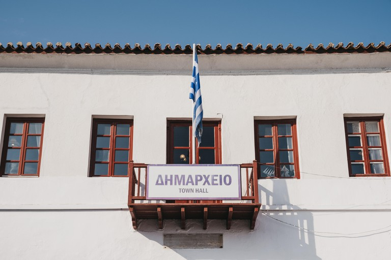 Mykonos Town, Greece - September 20, 2019: Facade of the Town Hall in Hora, also known as Mykonos Town, capital of the island and one of the best exam