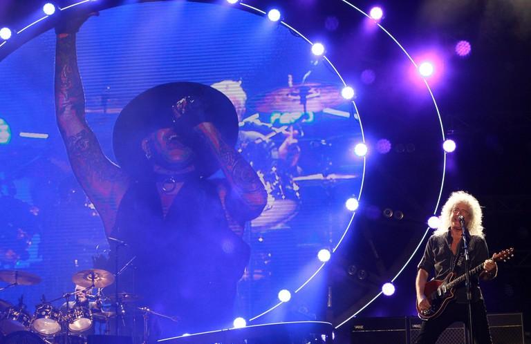 (160913) -- TEL AVIV, Sept. 13, 2016(Xinhua) -- Brian May (R) performs during the performance of Queen   Adam Lambert at Hayarkon Park in Tel Aviv, Israel, Sept. 12, 2016. (Xinhua/Gil Cohen Magen) (sxk)