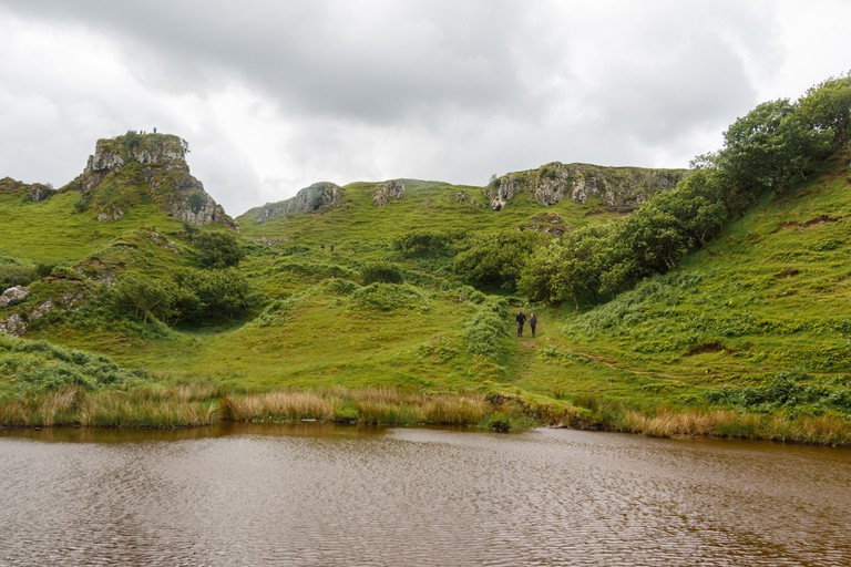 Discover the enchanted geological landscape of Fairy Glen, Isle of Skye, which looks like it could be the home to magical faeries.