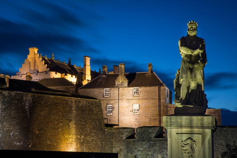 Twilight below Robert the Bruce statue and Stirling Castle, Stirling, Scotland. Image shot 2014. Exact date unknown.