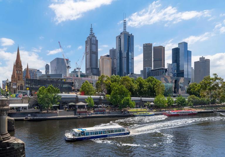 Melbourne River cruise boat on the Yarra River in front of the Central Business District (CBD), Princes Bridge, Melbourne, Victoria, Australia