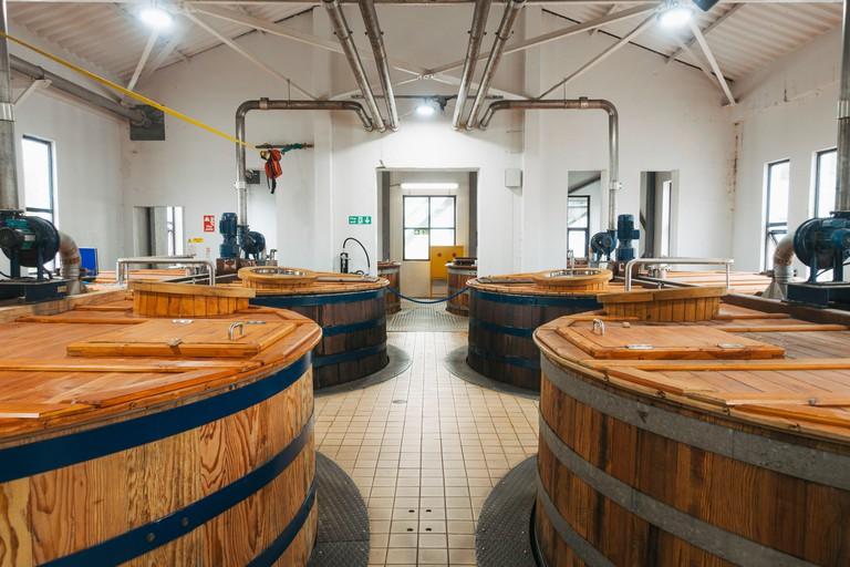 Whisky ferments in wooden washback tanks inside the Talisker Distillery on the Isle of Skye, Scotland