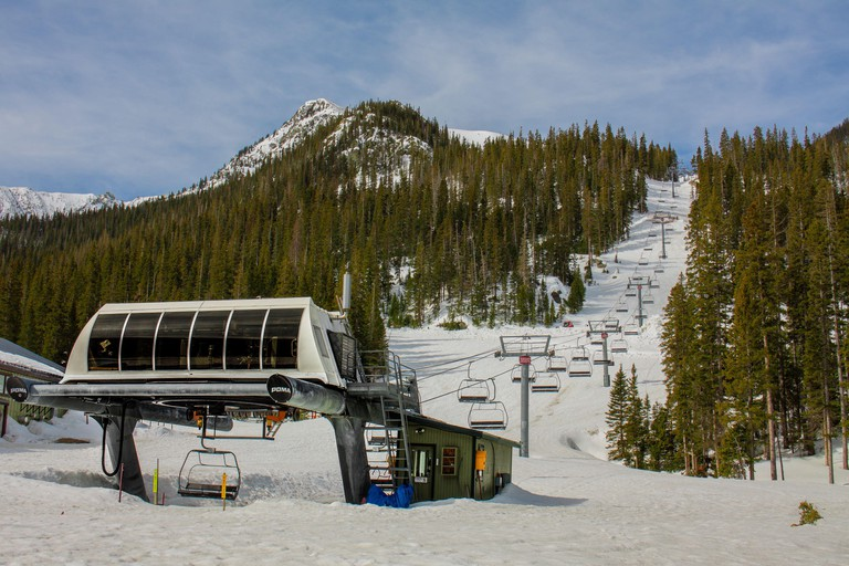 Taos, New Mexico / USA - April 24 2020: Empty chairlift in Taos Ski Valley in Taos, New Mexico on a sunny day