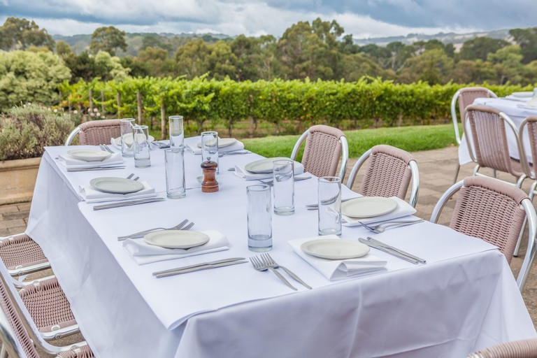 White served table outdoors in wineyard