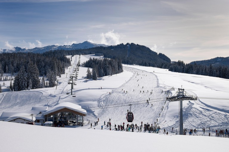 Germany, Reit im Winkl, snow-covered Winklmoosalm with chair lift